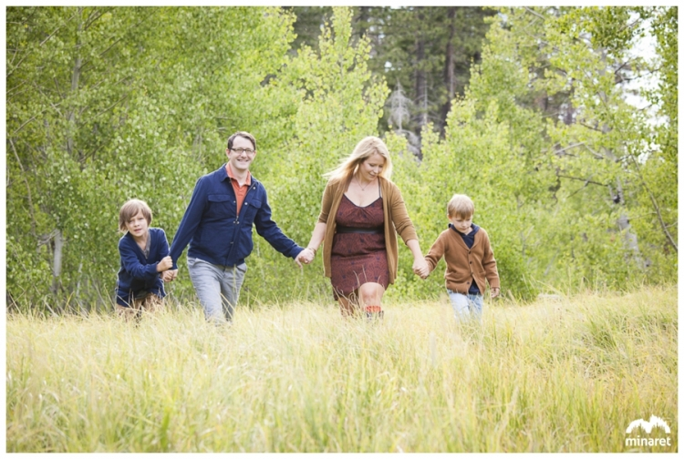 A family photo taken in an aspen grove near lake tahoe, family walking through grass